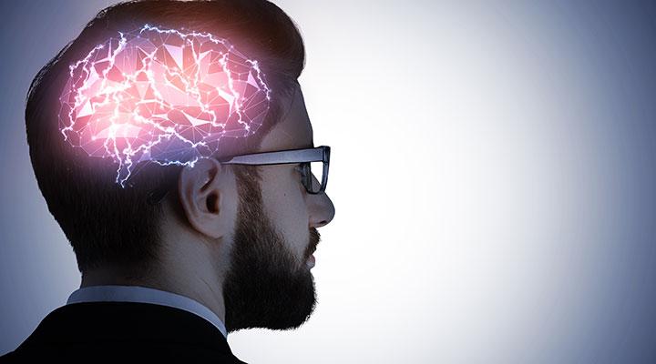 Man's head with the brain highlightedMental health