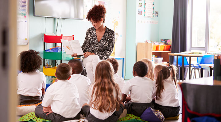 School teacher in a classroom with pupils